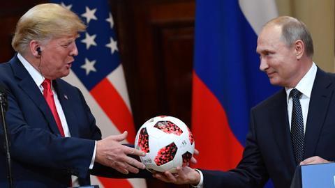 Trump backs Putin against US intelligence on election meddling