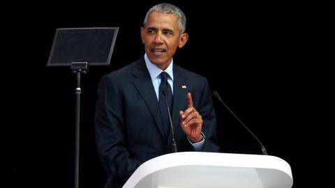 Obama gives Trump sharp rebuke in Mandela tribute on values