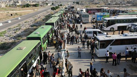 First evacuation convoy arrives in Syria's Idlib from Quneitra