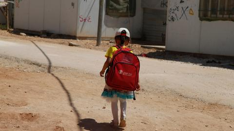 Displaced Syrian children use tent as classroom