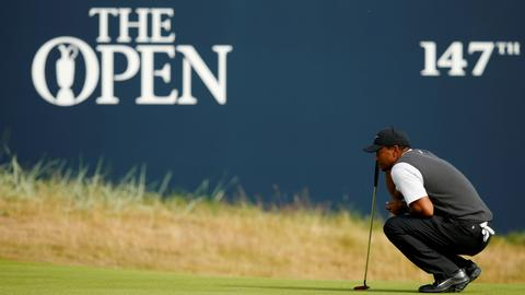 Sizzling 66 puts charging Tiger in the mix