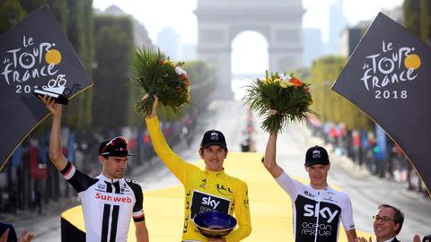 Britain's Geraint Thomas wins first Tour de France title