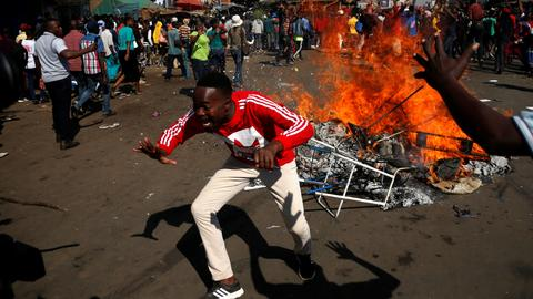 Opposition march turns to bloodshed after Zimbabwe vote