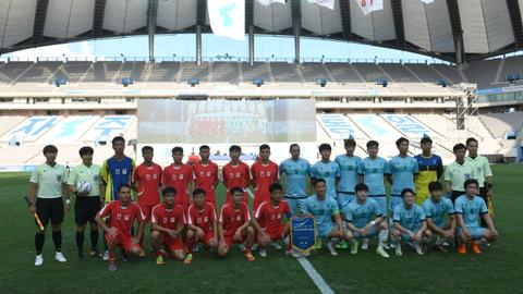 North and South Korea workers come together for football