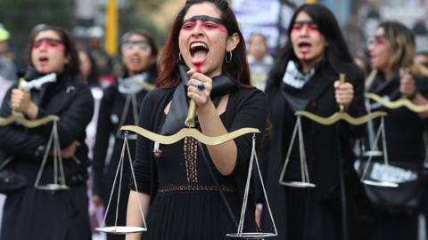 In pictures: Peruvians march to seek justice for female victims of abuse