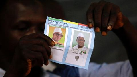 Mali counts votes after tense presidential run-off
