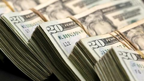 Dollar little changed as investors await trade news