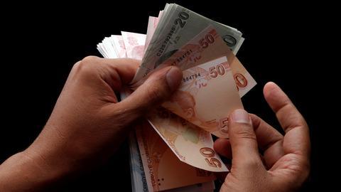 Turkish lira trades below 6.0 against the dollar