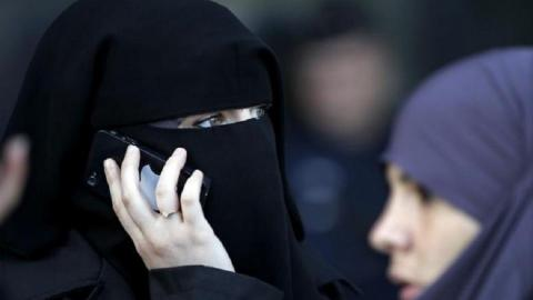 German chancellor calls for ban on Muslim veil