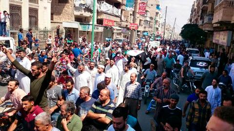 Thousands protest in Syria's Idlib against possible Assad offensive