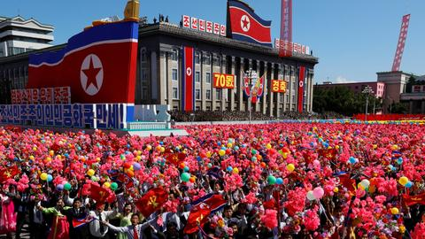 North Korea stages huge parade, holds back on advanced missiles