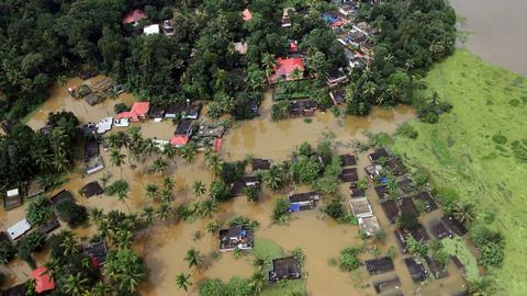 People in India's Kerala cope with floods aftermath