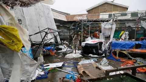 In pictures: typhoon brings heavy rains and chaos to north Philippines