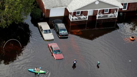 Rain-fed rivers rise as Florence death toll hits 32 in Carolinas