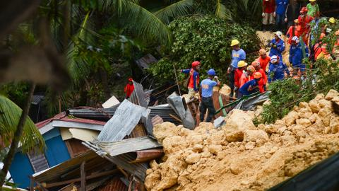 Landslide buries villages, killing at least 15 people in Philippines
