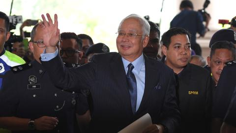Malaysia's ex-PM hit with fresh charges linked to 1MDB scandal