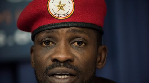 Uganda's Bobi Wine picked up by police on arrival home from US
