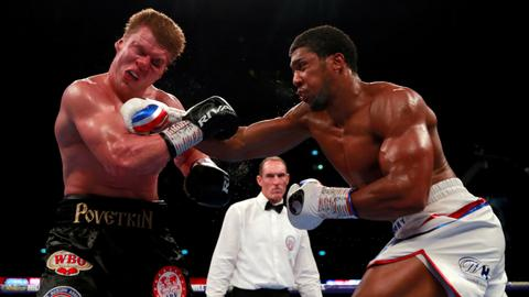 Boxing: Anthony Joshua defends world title with seventh-round knockout