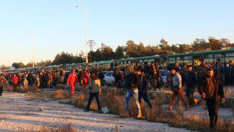 First convoy of eastern Aleppo civilians reaches rebel-held territory