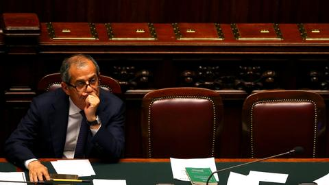 Italy hikes deficit, defying EU, as economy minister caves in