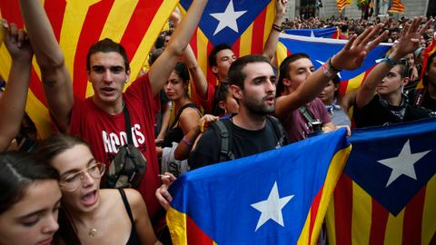 Separatists in Catalonia block roads, rail line a year after vote