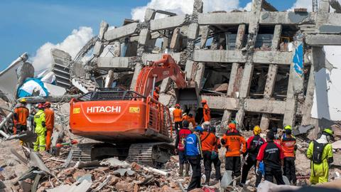 Indonesia races to save quake victims as death toll tops 1,300