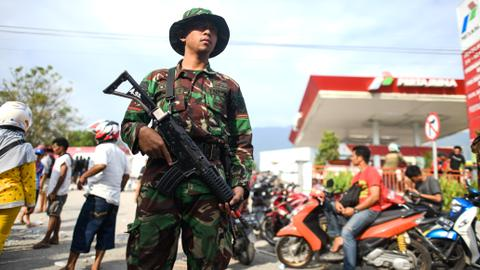 Desperation in Indonesia grows as soldiers ordered to clamp down on looting