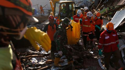 Indonesia disaster death toll nears 2,000, thousands still missing