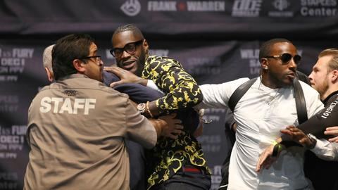 Heavyweight champ Wilder apologises after decking TV mascot