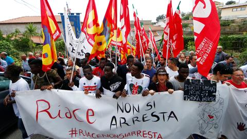 Migrants in Italy's Riace city to be transferred away