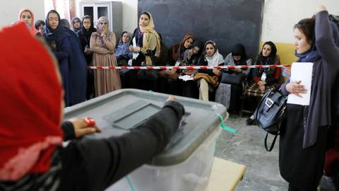 Afghanistan's violence-marred parliamentary elections enter second day