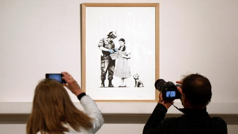 Banksy prints sell intact at stunt-free Paris auction