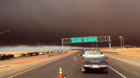 Thousands flee fast-moving northern California fire