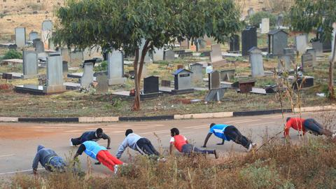 Poverty-stricken Zimbabwe residents live in cemeteries