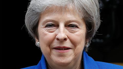 Theresa May takes Brexit deal to cabinet as MPs rebel
