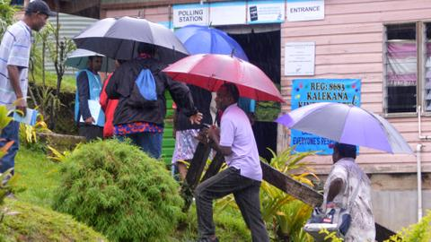 Heavy rain delays some polling as drenched Fijians vote