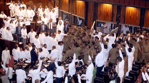 Chilli, furniture, punches thrown as brawl resumes in Sri Lanka parliament