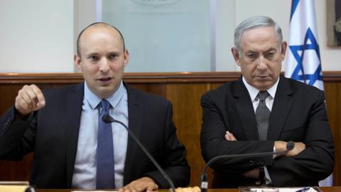 Israel's Netanyahu takes over defence job as coalition falters