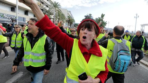 One woman dies in 'yellow vest' protests against Macron in France