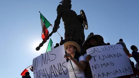 Tijuana protesters chant 'Out!' at migrants camped in city