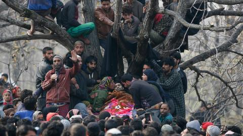 Tensions spike in Kashmir after assassination, gun battle leave six dead