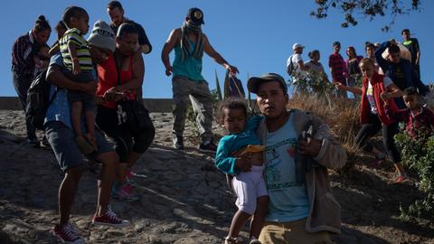 Migrants back to Mexico camp after failed US entry