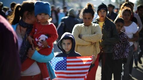 Tension at migrant caravan camp after Mexico border scuffle