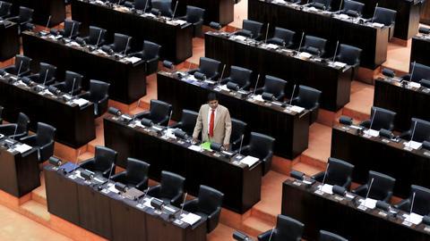 Sri Lanka parliament halts ministers' salaries to hinder disputed PM