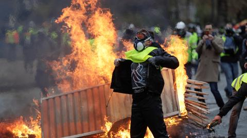 Chaos in Paris as protesters battle riot police, over 200 arrested