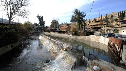 How did a natural water spring end up at the centre of the Syrian war?