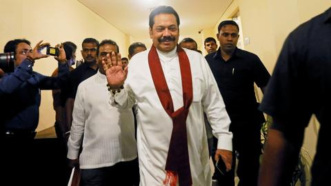 Sri Lanka court restrains Rajapaksa from acting as PM amid crisis