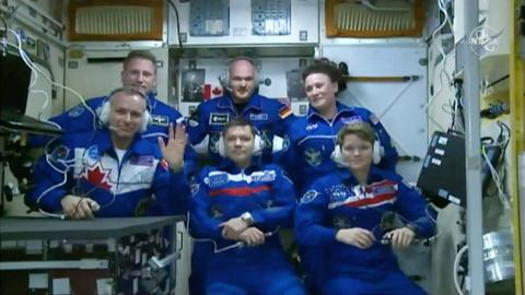 Three astronauts safely aboard International Space Station