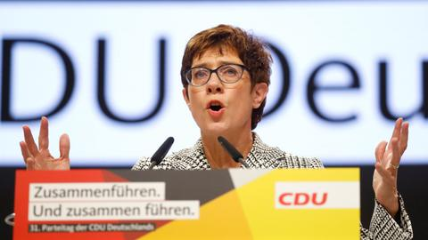 Merkel loyalist wins German party leadership battle