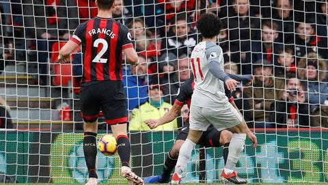 Superb Salah sends Liverpool to top of table
